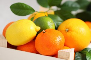 Fresh citrus fruits in a wooden box