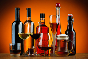 Bottles and glasses of different types of alcohol