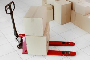 Stocking Equipment with boxes around and piled on top.