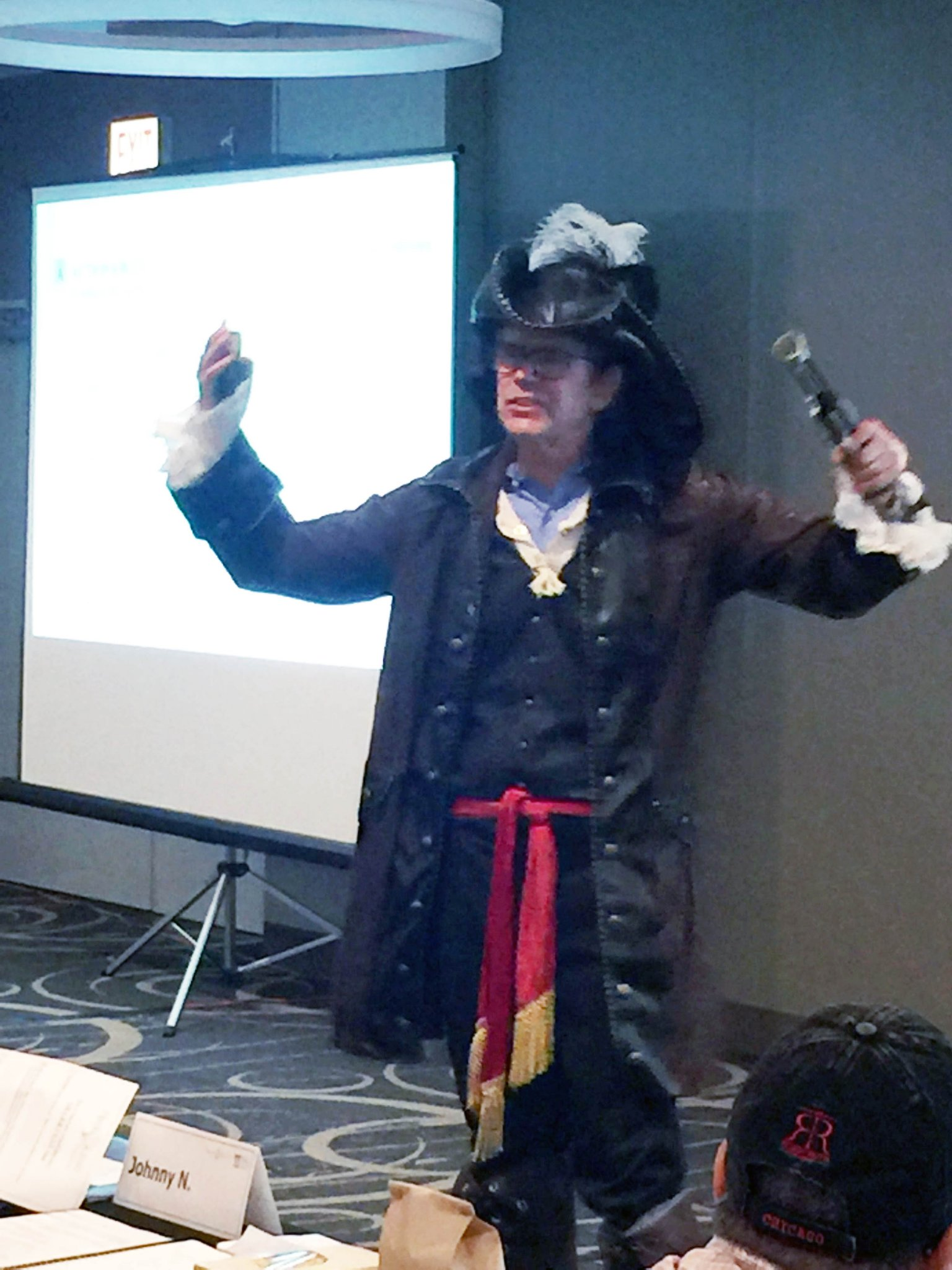 Harold Lloyd dressed as a pirate while giving his presentation