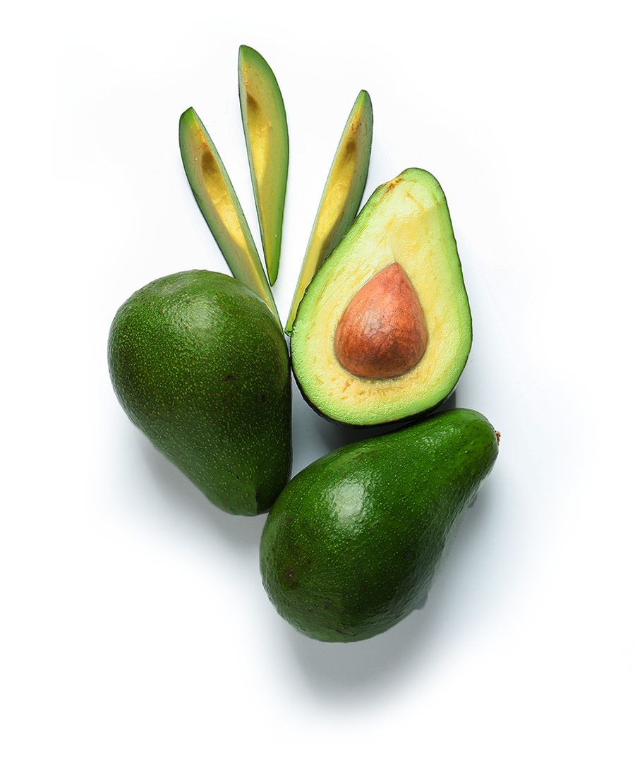 Avocados on a white table